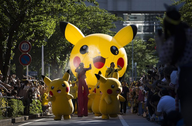 YOKOHAMA, JAPAN - AUGUST 07:  (EDITORIAL USE ONLY) Performers dressed as Pikachu, a character from Pokemon series game titles, march during the Pikachu Outbreak event hosted by The Pokemon Co. on August 7, 2016 in Yokohama, Japan. A total of 1, 000 Pikachus appear at the city's landmarks in the Minato Mirai area aiming to attract visitors and tourists to the city. The event will be held through Aug. 14.  (Photo by Tomohiro Ohsumi/Getty Images)