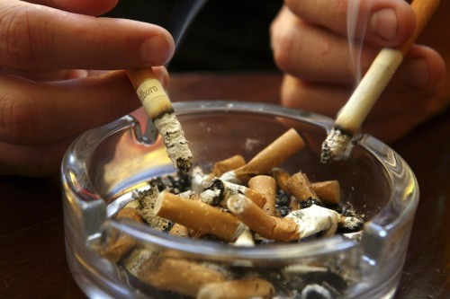 BATH, UNITED KINGDOM - JUNE 30:  A couple smoke  cigarettes in a public house in Bath, on June 30 2007 in Somerset, England. From 6am July 1 smoking in all enclosed places such as cafes and pubs will be banned.  (Photo by Matt Cardy/Getty Images)